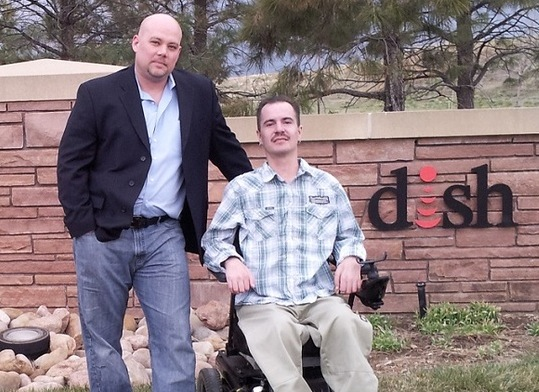Brandon Coats (in wheelchair) with attorney Michael Evans.